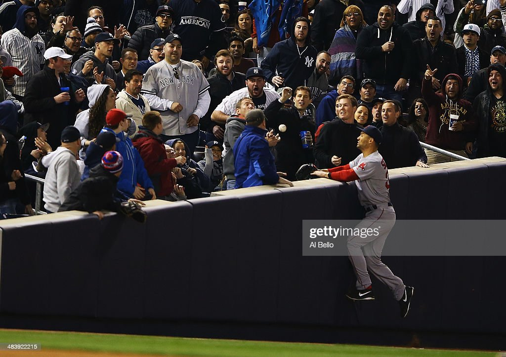 Grady Sizemore #38 of the Boston Red Sox cannot catch a foul ball into the crowd against the New York Yankees during their game at Yankee Stadium on April 10, 2014 in the Bronx borough of New York City.