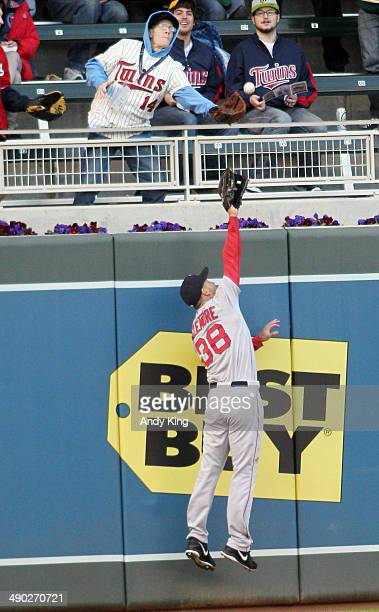 Grady Sizemore of the Boston Red Sox can't catch a home run by Eduardo Nunez of the Minnesota Twins in the second inning and the Twins beat the Red...