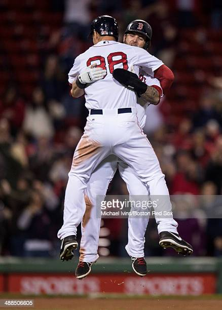 Grady Sizemore of the Boston Red Sox celebrates with Mike Napoli after hitting a gamewinning single against the Cincinnati Reds in the twelfth inning...