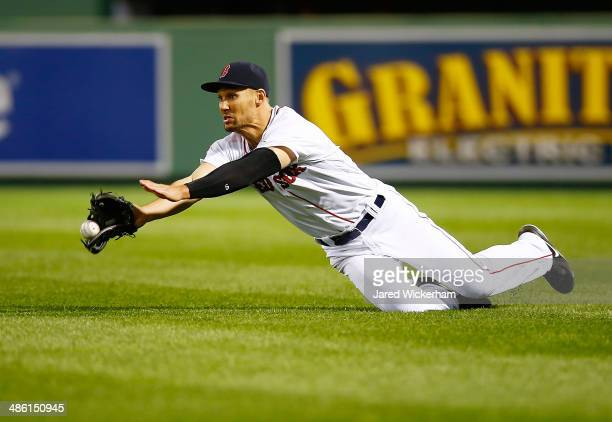 Grady Sizemore of the Boston Red Sox dives for a fly ball in right field but comes up short against the New York Yankees during the game at Fenway...