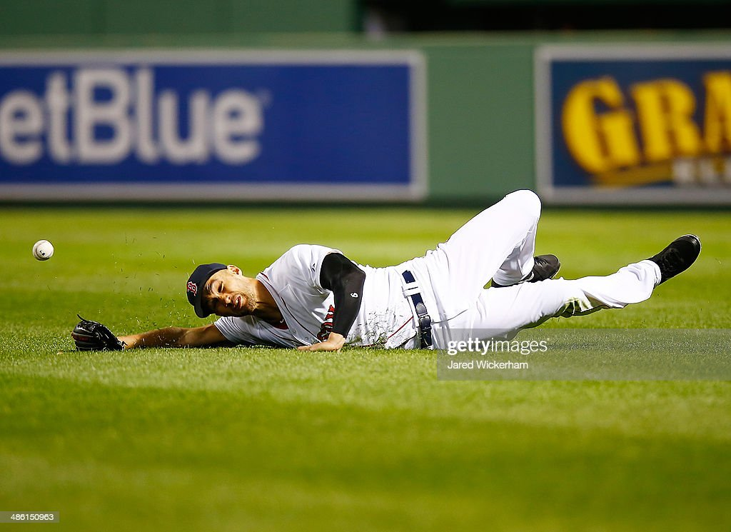Grady Sizemore #38 of the Boston Red Sox dives for a fly ball in right field but comes up short against the New York Yankees during the game at Fenway Park on April 22, 2014 in Boston, Massachusetts.