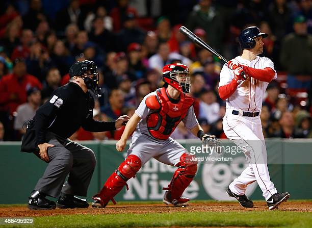 Grady Sizemore of the Boston Red Sox hits a walkoff single in the bottom of the 12th inning against the Cincinnati Reds during the interleague game...
