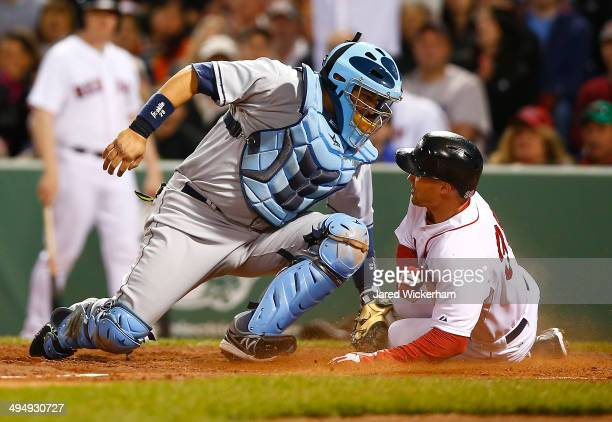 Grady Sizemore of the Boston Red Sox scores past Jose Molina of the Tampa Bay Rays in the fourth inning during the game at Fenway Park on May 31 2014...