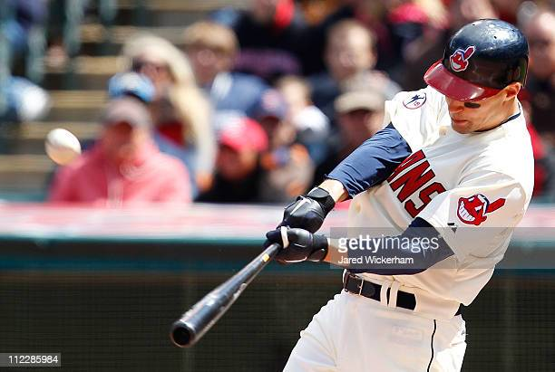 Grady Sizemore of the Cleveland Indians hits a solo home run against the Baltimore Orioles during the game on April 17 2011 at Progressive Field in...