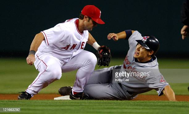 Grady Sizemore of the Cleveland Indians is tagged out by Adam Kennedy of the Los Angeles Angels of Anaheim on a stolenbase attempt in the seventh...