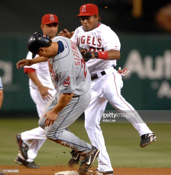Grady Sizemore of the Cleveland Indians tries to avoid the tag of Erick Aybar of the Los Angeles Angels of Anaheim during Major League Baseball game...