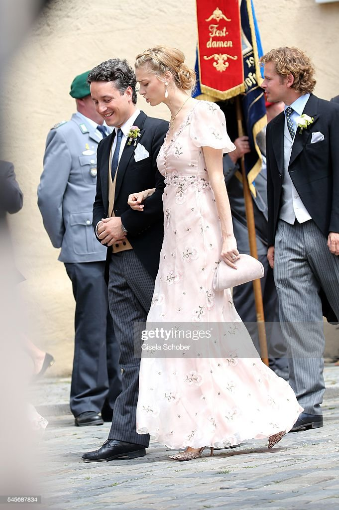 Graefin Beatrice Borromeo, wife of Pierre Casiraghi, and Alexander Graf Fugger-Babenhausen (L) during the wedding of hereditary Prince Franz-Albrecht zu Oettingen-Spielberg and Cleopatra von Adelsheim in Oettingen at St. Jakob Cathedral on July 9, 2016 in Oettingen near Donauwoerth, Germany.