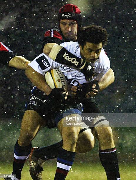 Graeme Bond of Sale Sharks is tackled by Alex Codling of Saracens during the Powergen Cup Fourth Round match between Sale Sharks and Saracens at...
