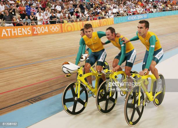 Graeme Brown Brett Lancaster Brad McGee and Luke Roberts of team Australia celebrate after winning the gold in the men's track cycling team pursuit...