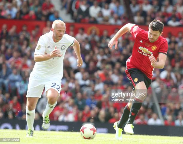 Graeme Carrick of Manchester United '08 XI in action with Eidur Gudjohnsen of Michael Carrick AllStars during the Michael Carrick Testimonial match...