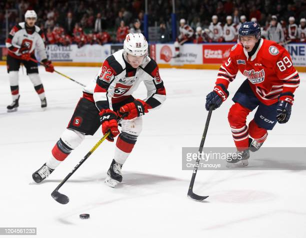 Graeme Clarke of the Ottawa 67's protects the puck from Cole Resnick of the Oshawa Generals during an OHL game at the Tribute Communities Centre on...