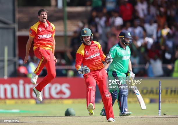 Graeme Cremer and Brendan Taylor of Zimbabwe celebrate the wicket of Paul Stirling of Ireland during The ICC Cricket World Cup Qualifier between...