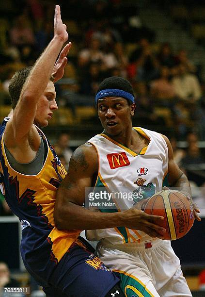 Graeme Dann of the Razorbacks defends as Rosell Ellis of Townsville looks to pass during the round one NBL match between the West Sydney Razorbacks...