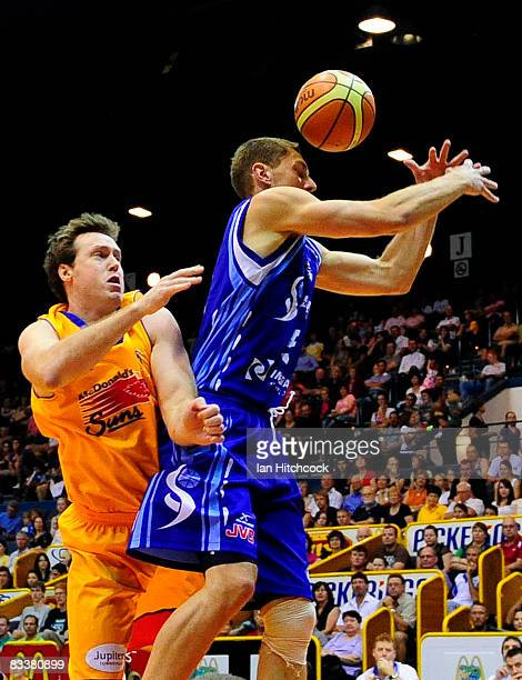Graeme Dann of the Spirit and Daniel Egan of the Crocs contest the ball during the round six NBL match between the Townsville Crocodiles and the...