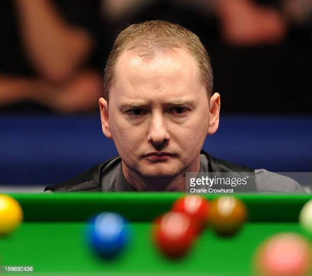 Graeme Dott of Scotland casts an eye over the table before his shot during his quarterfinal match against Judd Trump of England on day 6 of The...