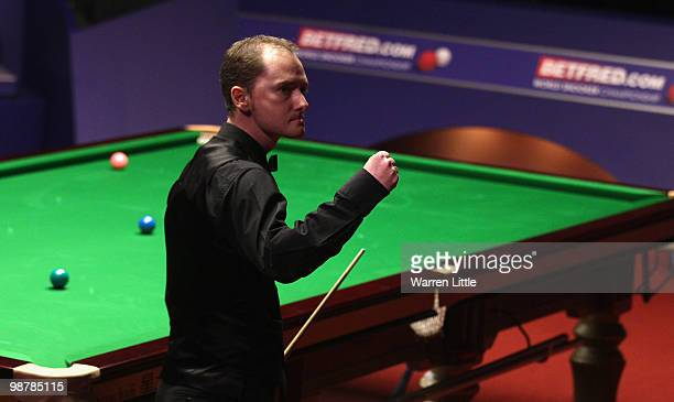 Graeme Dott of Scotland celebrates en route to beating Mark Selby of England in the semi final of the Betfredcom World Snooker Championships at The...