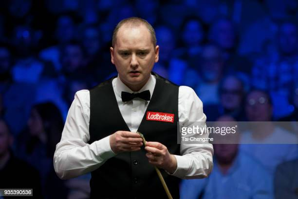 Graeme Dott of Scotland chalks the cue during his first round match against Ronnie O'Sullivan of England on day two of 2018 Ladbrokes Players...