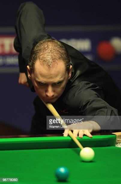 Graeme Dott of Scotland in action against Mark Selby of England during the semi final of the Betfredcom World Snooker Championships at The Crucible...