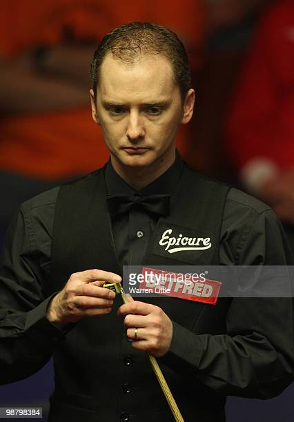 Graeme Dott of Scotland in action against Neil Robertson of Australia during the final of the Betfredcom World Snooker Championships at The Crucible...