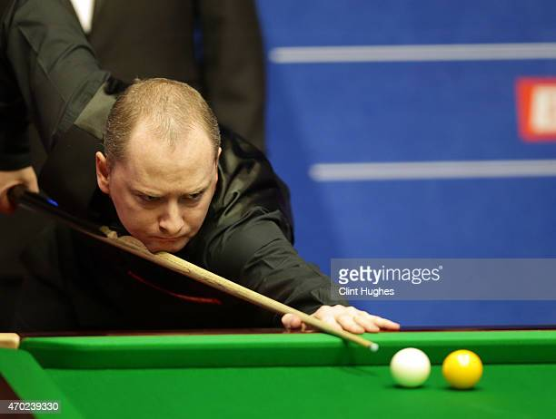 Graeme Dott of Scotland in action against Ricky Walden of England during day one of the Betfred World Snooker Championship at Crucible Theatre on...