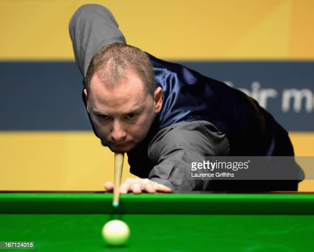 Graeme Dott of Scotland in action during his first round match against Peter Ebdon of England during the Betfair World Snooker Championship at the...