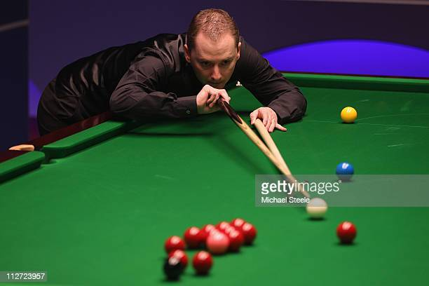 Graeme Dott of Scotland in the round one game against Mark King of England on day five of the Betfredcom World Snooker Championship at The Crucible...