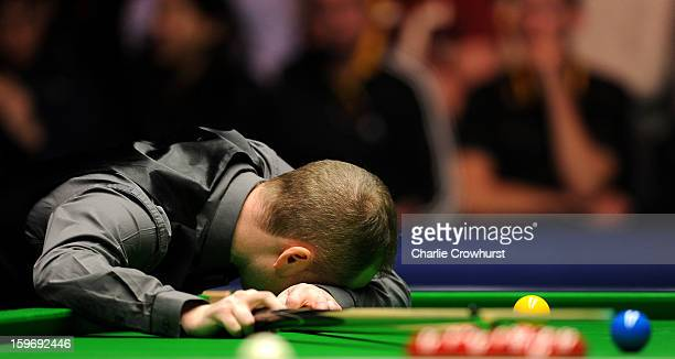 Graeme Dott of Scotland is dejected after missing an easy pot during his quarterfinal match against Judd Trump of England on day 6 of The Masters at...