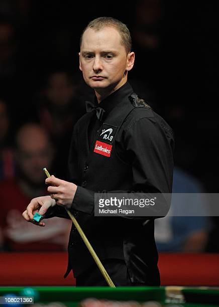 Graeme Dott of Scotland looks dejected during the Ladbrokesmobile Masters quarterfinal match against Ding Junhui of China at Wembley Arena on January...