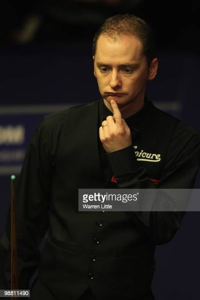 Graeme Dott of Scotland looks on against Neil Robertson of Australia during the final of the Betfredcom World Snooker Championships at The Crucible...