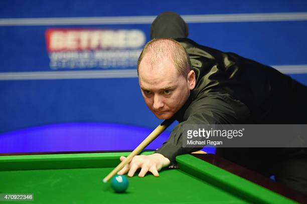 Graeme Dott of Scotland plays a shot against Stuart Bingham of England during day seven of the 2015 Betfred World Snooker Championship at Crucible...