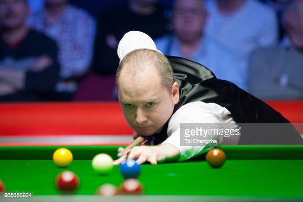 Graeme Dott of Scotland plays a shot during his first round match against Ronnie O'Sullivan of England on day two of 2018 Ladbrokes Players...