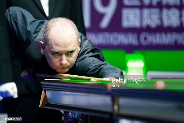Graeme Dott of Scotland plays a shot during the quarterfinal match against Shaun Murphy of England on day five of the 2019 World Snooker...