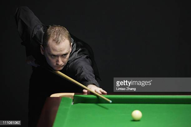Graeme Dott of Scotland plays a shot in his first round match against Li Xing of China during the 2011 China Open at Beijing University Students...
