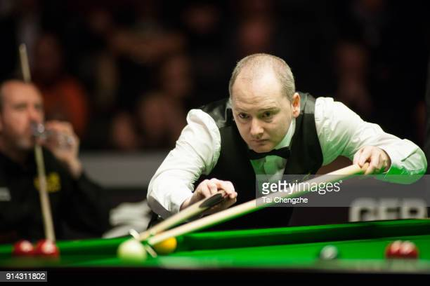 Graeme Dott of Scotland plays a shot in the final match against Mark Williams of Wales on day five of 2018 D88 German Masters at Tempodrom on...