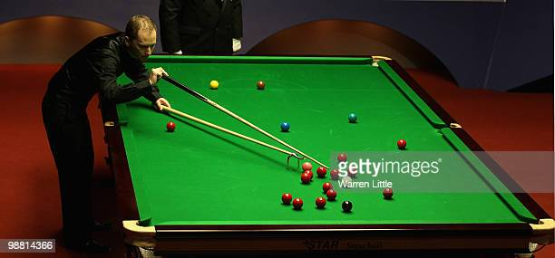 Graeme Dott of Scotland uses a swan rest against Neil Robertson of Australia during the final of the Betfredcom World Snooker Championships at The...