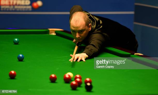 Graeme Dott plays a shot against Ali Carter during their first round match of the World Snooker Championship at Crucible Theatre on April 19 2017 in...