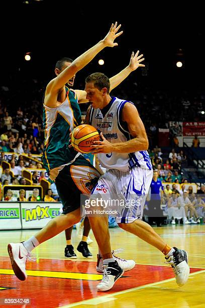 Graeme Dunn of the Spirit looks to get past Russell Hinder of the Crocs during the round 12 NBL match between the Townsville Crocodiles and the...