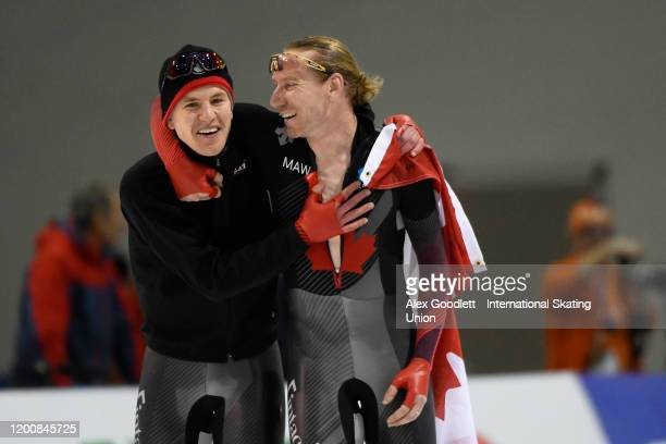 Graeme Fish and Ted-Jan Bloemen of Canada celebrate after Fish set a world record in the men's 10000 meter during the ISU World Single Distances...