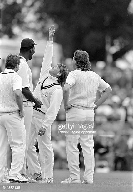 Graeme Fowler of Lavinia Duchess of Norfolk's XI challenges teammate Joel Garner to a highfive watched by Ian Botham during the tour match between...