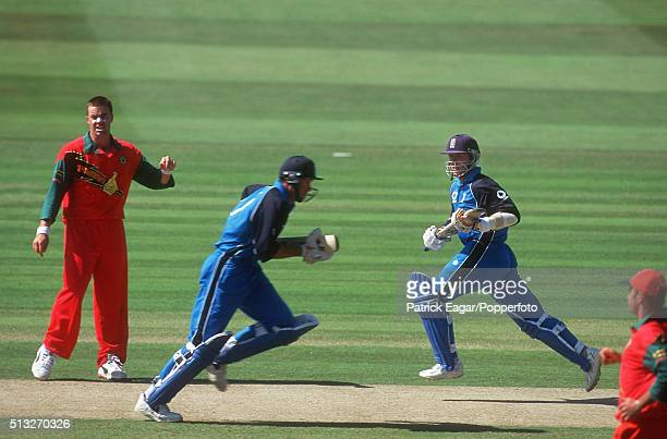 Graeme Hick and Alec Stewart running between the wickets as Heath Streak looks on during the NatWest Series Final between England and Zimbabwe at...