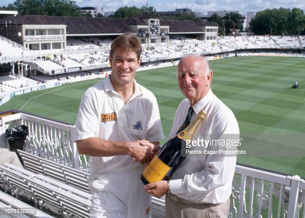 Graeme Hick of England is presented with a bottle of champagne by Test Match Special commentator Brian Johnston during the 4th Texaco Trophy One Day...