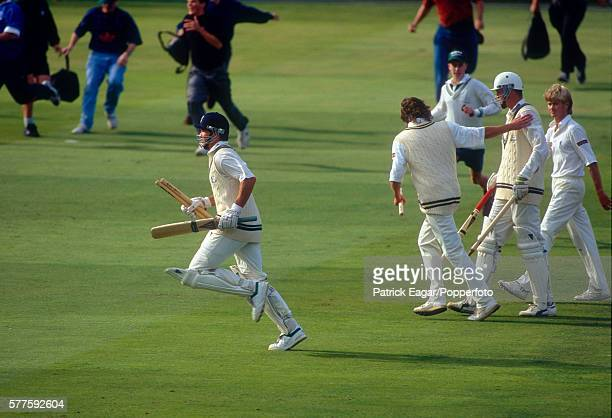 Graeme Hick of Worcestershire runs off the pitch followed by team mate Tom Moody and Warwickshire players at the end of the NatWest Bank Trophy Final...