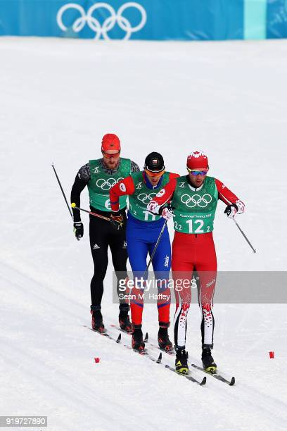 Graeme Killick of Canada Martin Jaks of the Czech Republic Thomas Bing of Germany compete during CrossCountry Skiing men's 4x10km relay on day nine...