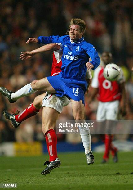 Graeme Le Saux of Chelsea battles in the air with Ray Parlour of Arsenal during the FA Cup Quarter Final Replay match between Chelsea and Arsenal at...