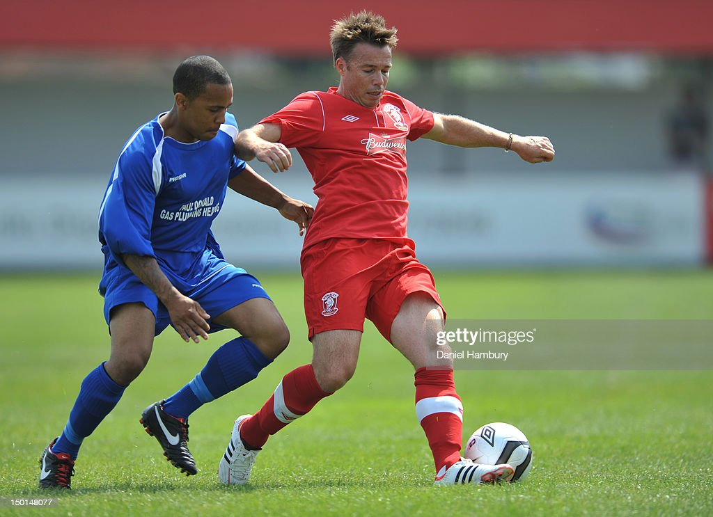 Graeme LeSaux of Wembley FC and Ashley Fitton of Langford FC during a Budweiser FA Cup Extra Preliminary Round at Vale Farm Stadium, on August 11, 2012 in Wembley, London, England.