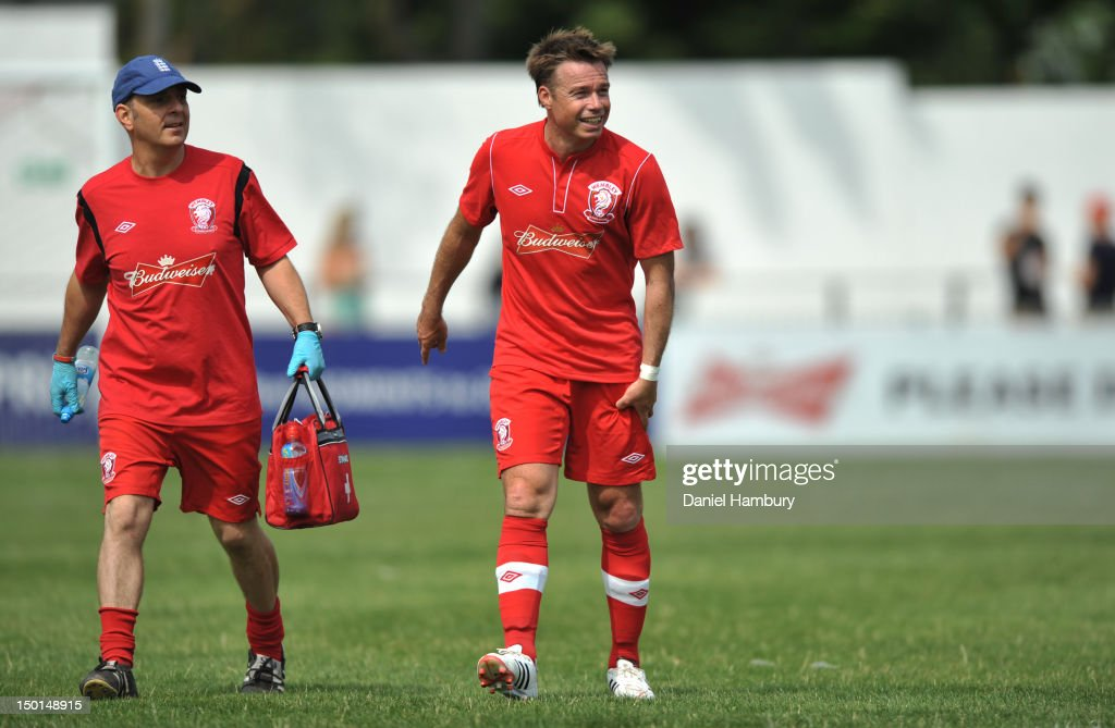 Graeme LeSaux (R) of Wembley FC leaves the pitch with an injury during a Budweiser FA Cup Extra Preliminary Round at Vale Farm Stadium, on August 11, 2012 in Wembley, London, England.