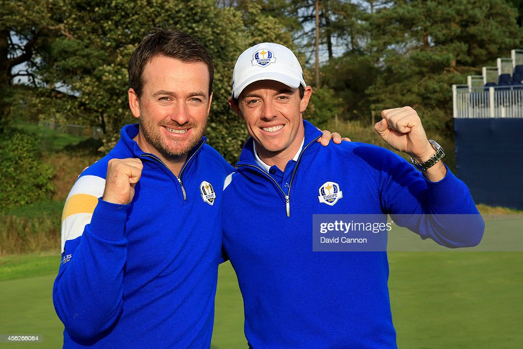 Graeme McDowell (L) and Rory McIlroy of Europe celebrate winning the Ryder Cup after Jamie Donaldson of Europe defeated Keegan Bradley of the United States on the 15th hole during the Singles Matches of the 2014 Ryder Cup on the PGA Centenary course at the Gleneagles Hotel on September 28, 2014 in Auchterarder, Scotland.