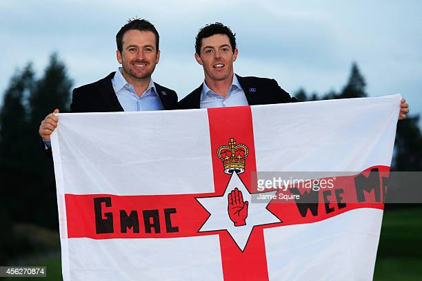 Graeme McDowell and Rory McIlroy of Europe celebrate winning the Ryder Cup after the Singles Matches of the 2014 Ryder Cup on the PGA Centenary...