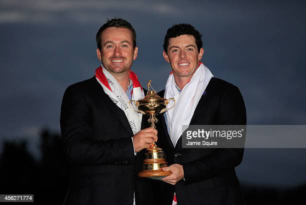 Graeme McDowell and Rory McIlroy of Europe pose with the Ryder Cup trophy after the Singles Matches of the 2014 Ryder Cup on the PGA Centenary course...