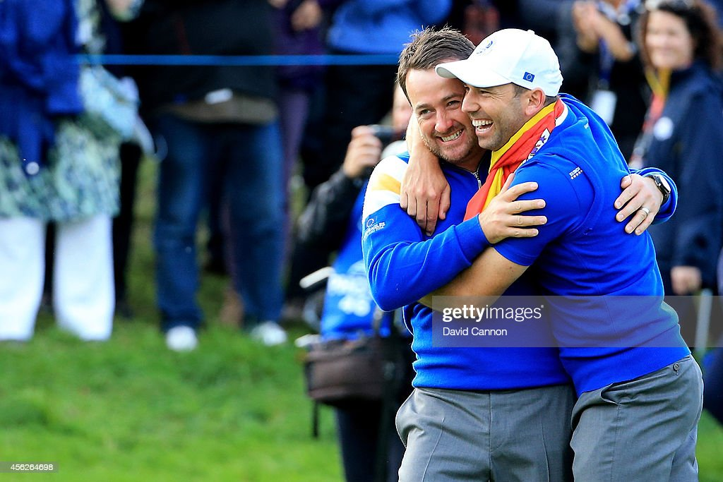 Graeme McDowell (L) and Sergio Garcia of Europe celebrate winning the Ryder Cup after Jamie Donaldson of Europe defeated Keegan Bradley of the United States on the 15th hole during the Singles Matches of the 2014 Ryder Cup on the PGA Centenary course at the Gleneagles Hotel on September 28, 2014 in Auchterarder, Scotland.